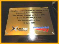 A plaque commemorating the 150th anniversary of the Inverness - Dingwall lines presented by David Simpson, Network Rail Managing Director in Scotland, to Richard Ardern of the Friends of the Far North Line before their AGM in Dingwall on 11 June 2012.<br><br>[John Yellowlees&nbsp;11/06/2012]