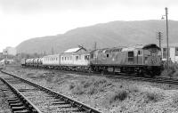 26032 standing in the down siding at Aviemore at the head of a weedkiller train in June 1978, with the Strathspey Railway main line in the foreground.<br><br>[Bill Roberton&nbsp;01/06/1978]