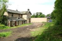 The old station at Gorebridge looking north west on 9 June. The blank wall is the rear of the garage block beyond which stood Harvieston Villas [see image 39137]. A bus is passing over the trackbed on Station Road bridge in the background.<br><br>[John Furnevel&nbsp;09/06/2012]