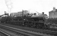 Hurlford based 2P 4-4-0 No. 40687 gives Standard Class 5 4-6-0 No. 73045 of Holbeck shed some assistance for the climb to Polquhap summit with the up <I>'Thames Clyde Express'</I> in August 1959, seen here prior to departing from Kilmarnock. <br><br>[Bill Jamieson&nbsp;/08/1959]