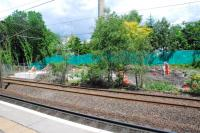 Some works for the new footbridge and surveying for the new additional eastbound platform at Hyndland station. View at west end of station looking north.<br><br>[Ewan Crawford&nbsp;12/06/2012]