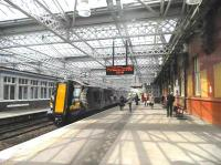 Transformation at Paisley Gilmour Street. Platform scene on 13 June 2012 under the new overall roof. [See image 34034]<br><br>[John Yellowlees&nbsp;13/06/2012]