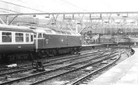 One of the Stratford 'Silverback' class 47s no 47115 waits to take out the 09.30 to Norwich from Liverpool Street in February 1983 as a class 37 arrives in the background with a train from Kings Lynn.<br><br>[John Furnevel&nbsp;04/02/1983]