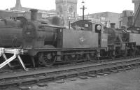 Ex-LMS locomotives stabled in the sidings at Kentish Town shed (14B) in October 1962. Class 3F 0-6-0T 47202 (of 1899 vintage) stands in front of 3P 2-6-2T no 40022. Both locomotives are fitted with condensing apparatus for operating over the Metropolitan widened lines.  <br><br>[K A Gray&nbsp;28/10/1962]