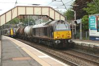 Royal locomotive 67006 <i>Royal Sovereign</i> on not-so-Royal duties passing through Johnstone on 31st May 2012 with train load of tanks heading for Dalry. <br><br>[Graham Morgan&nbsp;31/05/2012]
