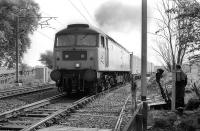 47114 draws away from Kaimes Siding with empty containers for Powderhall on 14 May 1990. Curiously, after diversion of the trains to Oxwellmains, the connection to the main line was removed, then re-instated. [See image 29822]<br><br>[Bill Roberton&nbsp;14/05/1990]