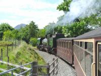The Welsh Highland Railway's Beyer-Garratt no 143 photographed on 14 June en route to Porthmadog.<br><br>[Peter Todd&nbsp;14/06/2012]
