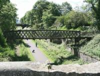 A young girl and her dog passing through the remains of Eskbank station on a bright and sunny afternoon. View south from the road bridge on 18 June 2012.<br><br>[John Furnevel&nbsp;18/06/2012]