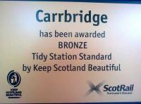 The new plaque on display at Carrbridge station in June 2012.... [welcome recognition for our planting, watering and litter picking over the past year. GC]<br><br>[Gus Carnegie /06/2012]