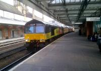 The garish colours and modern design of Colas Rail 66846 (hauling empty timber wagons South) contrasts with the old-fashioned architecture and muted colours of Shrewsbury station on 20 June 2012.<br><br>[Ken Strachan&nbsp;20/06/2012]