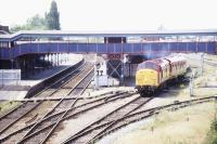 View west over March station on a sunny summer's day in July 1996, showing EWS 37057 hauling an EWS saloon about to come off the disused joint line.<br><br>[Ian Dinmore&nbsp;/07/1996]