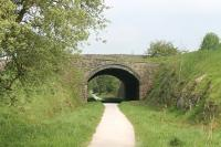 Like the other old stations on the <I>Tissington Trail</I> Alsop-en-le-Dale has been swept away since closure in 1954 and is only a car park and trail access point. Immediately north of the station site however is this fine bridge, still carrying the A515 Buxton to Ashbourne road over the old line, which has now been a cycle path for over forty years. View north towards Parsley Hay and Buxton. <br><br>[Mark Bartlett 24/05/2012]
