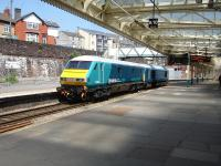 Arriva Trains Wales liveried 67003 heads a matching liveried DVT east through platform 4 at Newport on 22 May 2012.<br><br>[David Pesterfield&nbsp;22/05/2012]