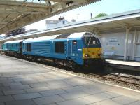 Arriva Trains Wales liveried 67003+DVT run east through Newport on 22 May 2012. <br><br>[David Pesterfield&nbsp;22/05/2012]