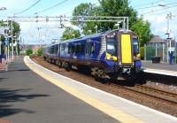 A train from Gourock to Glasgow Central calls at Port Glasgow 1 June 2012 in some welcome sunshine.<br><br>[Colin Miller&nbsp;01/06/2012]