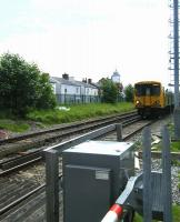 A Liverpool bound Merseyrail emu approaching Duke Street level crossing on 12 June shortly after leaving Southport station.<br><br>[Veronica Clibbery&nbsp;12/06/2012]