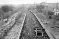 Looking east over Corkerhill station in February 1990, with new platform under construction on the left and the electrified headshunt from Corkerhill depot on the right. The station reopened in July that year. The housing development stands on the site of the original 'Corkerhill railway village' [see image 19972].<br><br>[Bill Roberton 24/02/1990]