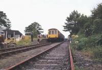 A DMU at Petrockstow, North Devon, in August 1982 with a railtour bound for Meeth. Closed to passengers in 1965 the line continued to carry freight from the Meeth quarries until 1982. [Editors note: Another railway station whose name was spelt differently (without the final 'e') from that of the village it served.] [See image 39828]<br><br>[Ian Dinmore&nbsp;/08/1982]