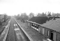 View west over Crookston station from Crookston Road bridge on 24 February 1990 showing the fire-damaged station building. [See image 15060]<br><br>[Bill Roberton 24/02/1990]