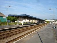 Looking east from the down island platform at Whitland in May 2012. The station buildings on the up platform are empty and boarded up and give a generally poor impression to travellers. <br><br>[David Pesterfield&nbsp;23/05/2012]