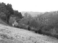 Lambley station and viaduct viewed from the south west in March 1976. Looking at the sylvan surroundings, it is difficult to imagine that there was once a coalfield immediately to the west of here, served by Lord Carlisle's Brampton Railway, which ran through from Brampton to Lambley.<br><br>[Bill Jamieson&nbsp;27/03/1976]