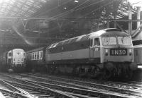 Brush type 4 no 1777 about to take a train out of Liverpool Street station in March 1970. In the background is one of the less than successful BTH Type 1 locomotives no D8234, put to work by Stratford shed that day as station pilot. This particular example was withdrawn the following March after ten and a half years operational service. <br><br>[John Furnevel&nbsp;10/03/1970]