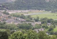 A six-car Class 170 set approaches Stirling from Perth with a Sunday afternoon service. Above the train the Alloa line can be seen curving away. This view taken from Stirling Castle. <br><br>[Mark Bartlett&nbsp;01/07/2012]