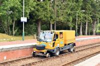 The operation to reopen the West Highland Line and recover GBRf 66734 [see image 39479] is being managed from Tulloch and this ro-rail vehicle is seen there on 4 July 2012 about to take more workers to the site.<br><br>[John Gray&nbsp;04/07/2012]