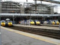 A symmetrical line up of HSTs and class 91s beneath ongoing glazing works on the north end screens at Kings Cross on 13 June 2012.<br><br>[David Pesterfield&nbsp;13/06/2012]