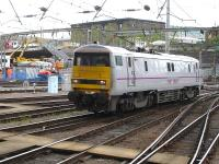 East Coast Trains 91112 runs back into platform 3 at King Cross on 13 June to attach to a Mk 4 rake and take over from 91124 which was in need of attention at Bounds Green depot. <br><br>[David Pesterfield&nbsp;13/06/2012]
