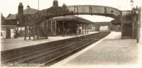 General view of Johnstone Station, probably taken around 1930. Note Johnstone No.1 Signal Box just beyond the bridge, controlling Johnstone Junction amongst other things. Johnstone No.2 Signal Box was slightly South of the station and lasted until 1985 when it burned down <br><br>[Graham Morgan Collection&nbsp;//1930]