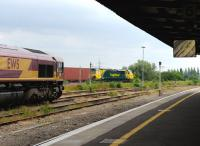 66096 and 70009 with freights at Didcot.<br><br>[Peter Todd 28/06/2012]