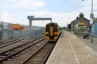 Having shuttled to Thurso and back 158702 runs in to Georgemas Junction ready to continue on to Wick. In the background the new crane and loading area for the Dounreay flasks are nearing completion and as a result the footbridge has gone and the old platform has been incorporated into the perimeter fence. [See image 12679] for the same location in 1989. A few days after this photo was taken two DRS Class 37s with a nuclear flask wagon made a timing run to Georgemas Junction ahead of the Dounreay traffic commencing in earnest.<br><br>[Mark Bartlett&nbsp;06/07/2012]