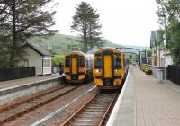 Strathcarron station, a lovely spot, sees trains cross twice a day. This view in July 2012 shows 158715 heading for Kyle with 158719 eastbound for Inverness. <br><br>[Mark Bartlett&nbsp;11/07/2012]