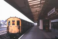 Platform scene at Eastbourne station in November 1988. No. 1107 is a Class 207 DEMU, in this case with a substitute DMBS vehicle from a Class 202 or 203 Hastings unit.<br><br>[Ian Dinmore&nbsp;/11/1988]
