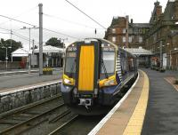380104 waits at a gloomy Ayr station on 18 July with the 12.13 to Glasgow Central.<br><br>[Bill Roberton&nbsp;18/07/2012]