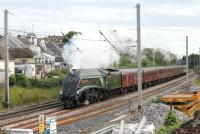 With that distinctive whistle chiming <I>Union of South Africa</I> runs north through Hest Bank on the final leg of a main line test with a full rake of coaches. 60009 had been on a circuit from Carnforth via Hellifield and Blackburn on 18 July with WCRC (ex-Advenza) 57006 on the rear as insurance.<br><br>[Mark Bartlett&nbsp;18/07/2012]