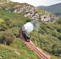 Black 5 no 45407 <I>The Lancashire Fusilier</I> at the head of 'The Royal Highlander' tackles the 1 in 50 out of Lochailort heading for Mallaig.<br><br>[John Gray&nbsp;/07/2012]