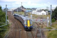 380 111 heading south past the closed Ayr MPD in July 2012 on the approach to Ayr station [see image 5610]. <br><br>[Bill Roberton&nbsp;19/07/2012]