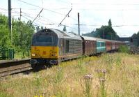 A Barrhead travel company has this year organised rail charters between Glasgow and Southampton in connection with cruises from the port. On 14 July 2012 a return service is seen across the overgrown southern end of platforms 2 & 3 at Leyland with DBS 67005 <I>Queen's Messenger</I> heading a converted Mk 1 vehicle for luggage and a mixture of Mk 2s featuring Anglia and Virgin colour schemes.<br><br>[John McIntyre&nbsp;14/07/2012]