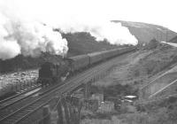 Climbing near Dalnacardoch, circa 1960. An unidentified Black 5 is at the head of the train with standard class 4 2-6-4T no 80126 banking in the rear.<br><br>[Frank Spaven Collection (Courtesy David Spaven)&nbsp;//1960]