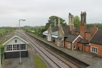Although it closed in 1993 Brocklesby's listed station building is still in good order standing alongside the very busy junction for the Grimsby and Immingham lines. View east from the road bridge. <br><br>[Mark Bartlett&nbsp;21/05/2012]