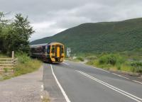 158715 on a Kyle to Inverness service crosses the A890 at Balnacra between Strathcarron and Achnashellach. A railwaymen's halt was located here at one time but no public station.<br><br>[Mark Bartlett&nbsp;07/07/2012]
