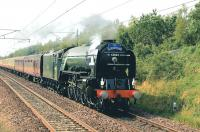 Heading for London King's Cross, A1 Pacific no 60163 <I>Tornado</I> races along the East Coast Main Line near Musselburgh on 25 July 2012 hauling 'The Elizabethan' Diamond Jubilee Special.<br><br>[John Gray&nbsp;25/07/2012]