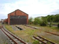 The unused country end of Vale of Rheidol's former Aberystwyth steam shed with disconnected standard gauge ash pits still in situ. Photographed on 30 May 2012 from the 10.30 service to Devils Bridge. <br><br>[David Pesterfield&nbsp;30/05/2012]