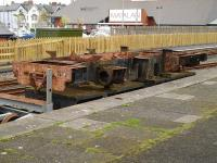 The frames of Vale of Rheidol No 7 <I>Owain Glyndwr</I> sit on a flat wagon alongside the former standard gauge platform 1 at Aberystwyth on 10 May 2012. The cargo is awaiting completion of the new Vale of Rheidol Railway heavy maintenance works before rebuilding can start in earnest. <br><br>[David Pesterfield&nbsp;10/05/2012]