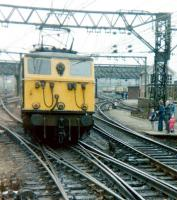 76025 approaching the platforms at Guide Bridge on 21 April 1981. The locomotive is about to take over the LCGB <I>Easter Tommy</I> railtour. The special, which had arrived from Liverpool behind a pair of class 25 diesel locomotives, was electrically hauled from here via Woodhead as far as Rotherwood sidings. [See image 19204]<br><br>[Colin Alexander&nbsp;21/04/1981]