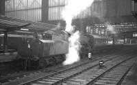 Kingmoor shed's Ivatt 2-6-0 no 43103 stands at Carlisle platform 4 on 14 March 1964 with a Langholm train.<br><br>[K A Gray&nbsp;14/03/1964]