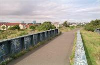 A 1997 view south from the 'new' girder bridge at Crew Junction with the former line to Granton on the left and to Leith North on the right, both long closed. In the left background are the gasometers at Granton [see image 26659].<br><br>[Ewan Crawford&nbsp;//1997]