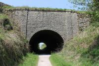 Newhaven Tunnel is on the High Peak Trail just to the south of the junction with the Tissington Trail. It carries the A515 Buxton to Ashbourne road over the old line and bears stone plaques over each portal commemorating its construction in 1825. View towards Parsley Hay.<br><br>[Mark Bartlett&nbsp;24/05/2012]